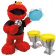 Everyone's favourite dinky muppet Elmo has a brand new rocking attitude with this new Lets Rock Elmo toy. Kitted out with his concert tee-shirt, microphone, drum set and tambourine, kids will just love hearing Elmo sing and make music all day long! Plus kids can also either play on Elmo's instruments or interact with Elmo on other Let's Rock instruments...